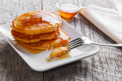 Pancakes fritters carrot with maple syrup breakfast Stock Images