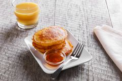 Pancakes fritters carrot with maple syrup breakfast. Pancakes fritters carrot with maple syrup Stock Images
