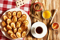 Pancakes or fritters on wooden background Royalty Free Stock Photos