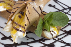 Pancakes with fruit. Pancakes with fruit, whipped cream in chocolate Royalty Free Stock Images