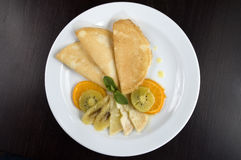 Pancakes with fruit. Pancakes with fruit on a white plate Stock Images