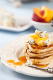 Pancakes with fruit and cheese. Small pancakes with blue cheese, fruit and honey Stock Photos