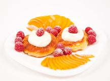 Pancakes with fruit in cream Royalty Free Stock Image