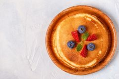 Pancakes with fruit, honey, maple syrup. Top view stock photography