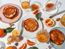 Pancakes with fruit, honey, nuts. The concept of a delicious breakfast. Top view stock photos