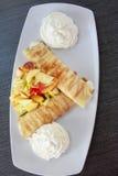 Pancakes and fruit salad Royalty Free Stock Photos
