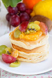 Pancakes with fruit salad Royalty Free Stock Image