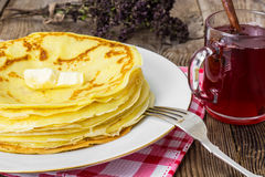 Pancakes and fruit tea with cinnamon Royalty Free Stock Image