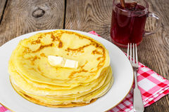 Pancakes and fruit tea with cinnamon Stock Images