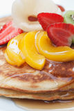 Pancakes with fruits. Delicious pancakes with fruits and syrup Stock Image