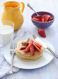 Pancakes with fruits. Delicious pancakes on morning breakfast table with strawberry Royalty Free Stock Image