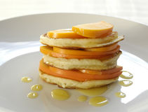 Pancakes with fruits and honey Stock Photo