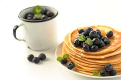 Pancakes with fruits and honey Royalty Free Stock Photography