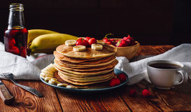 Pancakes with Fruits, Maple Syrup and Cup of Tea. Homemade Pancakes with Fruits, Maple Syrup and Cup of Tea stock photography