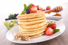 Pancakes and fruits Stock Photos