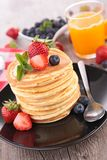 Pancakes and fruits Royalty Free Stock Images