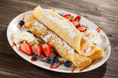 Pancakes with fruits Stock Photo