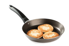 Pancakes In Frying Pan Stock Images