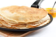 Pancakes in a frying pan. Fresh, delicious dessert Royalty Free Stock Photography
