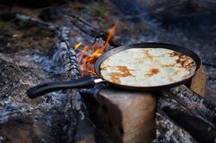 Pancakes on a fire royalty free stock photos