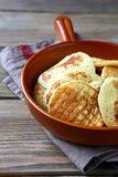 Pancakes in a frying pan Stock Image