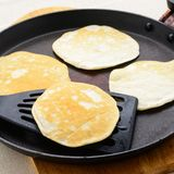 Pancakes in a frying pan Royalty Free Stock Photography