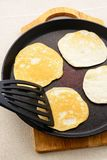 Pancakes in a frying pan Royalty Free Stock Photo