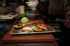 Pancakes in a frying pan Stock Image