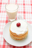 Pancakes and a glass of milk Stock Photos