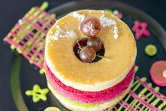 Pancakes with grape on black dish Stock Photo