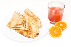 Pancakes with grapefruit juice and clementine Royalty Free Stock Photography