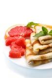 Pancakes with grapefruit Stock Photos