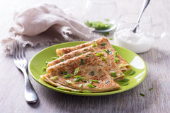 Pancakes with green onions and sour cream Royalty Free Stock Photo