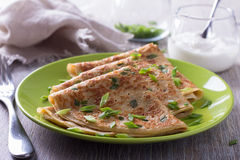 Pancakes with green onions and sour cream Royalty Free Stock Photos