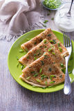Pancakes with green onions and sour cream Royalty Free Stock Photography