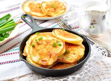 Pancakes with ham, cheese, green onions and sour cream Royalty Free Stock Photography
