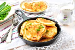 Pancakes with ham, cheese, green onions and sour cream Stock Photo
