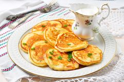 Pancakes with ham, cheese, green onions and sour cream Stock Images