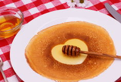 Pancakes heart with honey, flower and cutlery Royalty Free Stock Image