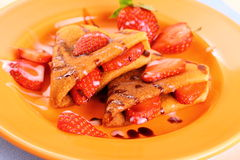 Pancakes hearts with strawberry, chocolate, sugar milk Royalty Free Stock Images