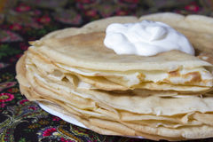 Pancakes for a holiday of spring. The Russian traditional dish, the main thing during  Shrovetide, a symbol of spring and the sun Royalty Free Stock Images