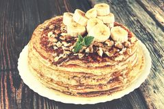 Pancakes, homemade, bakery, Russian pancakes, homemade, honey, c. Homemade pancakes closeup. A pile of Russian pancakes with honey. Country style Stock Photography