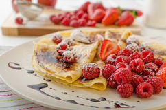 Pancakes with homemade balsamic reduction and fresh fruit Royalty Free Stock Image
