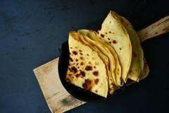 Pancakes. Homemade pancake crepe     in cast-iron pan on black background Royalty Free Stock Photo