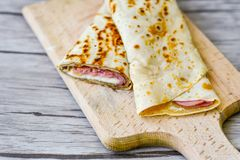 Pancakes. Homemade pancakes  with  yellow cheese and ham Royalty Free Stock Photos