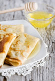 Pancakes with honey Royalty Free Stock Photos