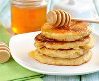 Pancakes with honey Royalty Free Stock Photo