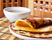 Pancakes and honey. Thin pancake and some sweet honey Royalty Free Stock Photos