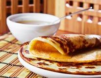 Pancakes and  honey Royalty Free Stock Photos