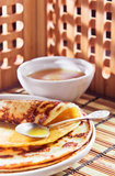 Pancakes and honey. Thin pancake and some sweet honey Stock Images
